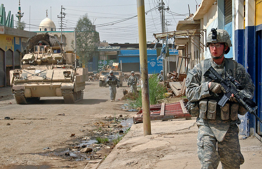 Pfc. Adam Devries patrols the streets of Mosul.  DVIDS.  Photo by Sgt. John Crosby.