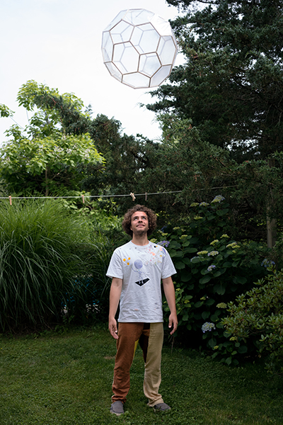 With one of his floating polyhedrons, influenced by the work of Buckminster Fuller.  Photo by Tara Israel.