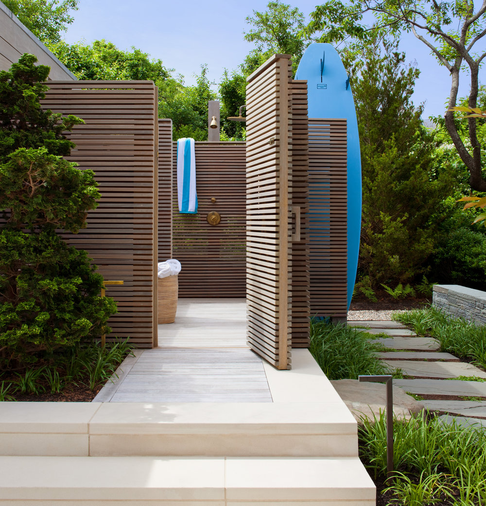 8. Hidden outdoor shower enclosure with integrated surfboard storage.jpg