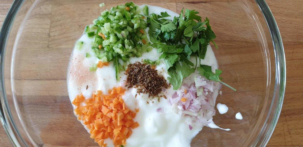 adding veg to yogurt.jpg