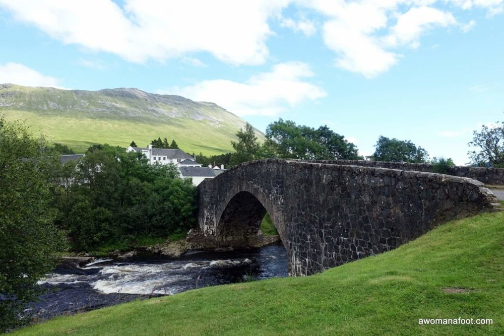 Crossing the Bridge of Orchy on my female solo hike along the West Highland Way. awomanafoot.com