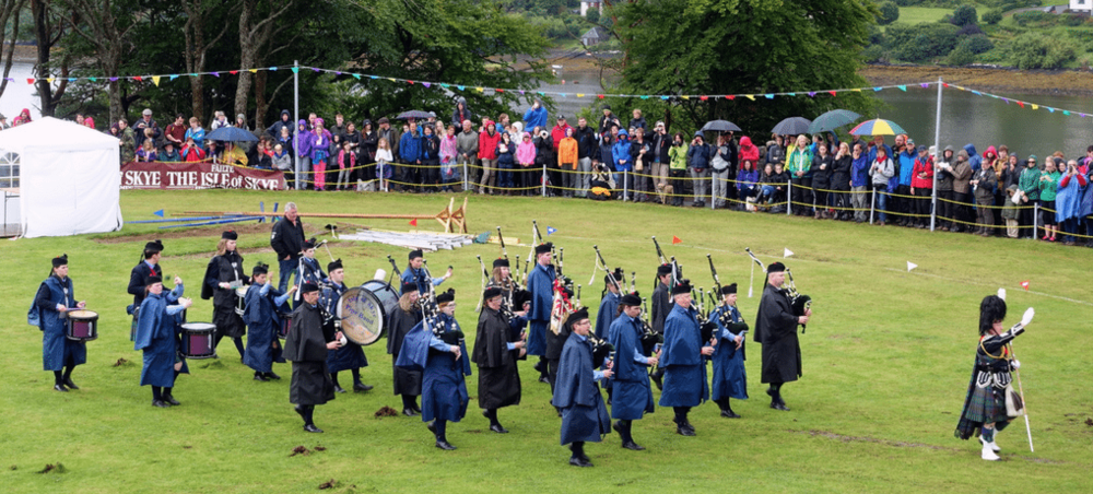 Seeing the Highland Games in Scotland is a real treat! Check it out - awomanafoot.com | #Scotland #Highland #Skye #Portree | What to see in Scotland | Scottish Culture | Scottish Tradition