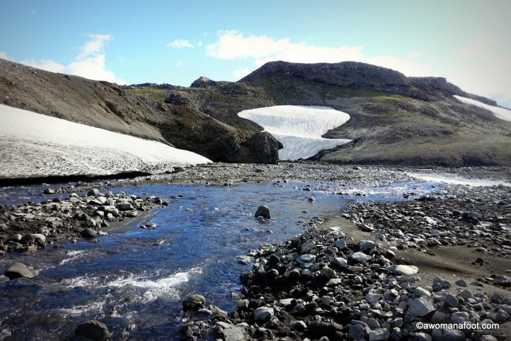 The Fimmvörðuháls trail in southern Iceland is a challenging and stunningly beautiful hiking path leading through the Land of Fire and Ice. Hiking in Iceland | Iceland Travel | Solo travel | Awomanafoot.com