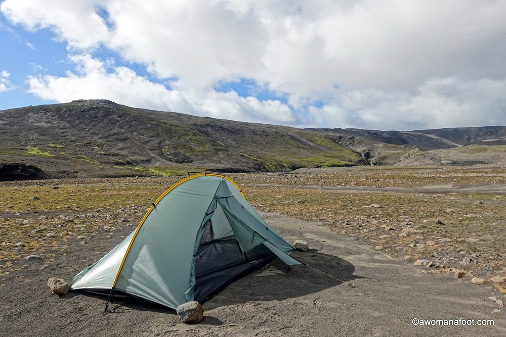 You can use rocks to hold your tent down.