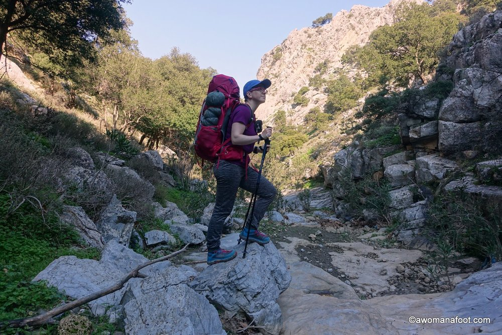 Hiking along the E4 on Crete - in the Iraklio/Heraklion district. Walking solo through charming villages, olive groves, and vineyards - and wild camping under olive branches. From Ano Asites, through Profiti Ilias to just before Archanes. Awomanafoot.com #hiking #E4trail #Crete #solo #FemaleHikers #WomenHiking #WildCamping #Trail | What to do on Crete | HIking on Crete | Visit Crete | Adventures on Crete |