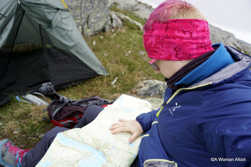 Getting ready for solo adventure in Norway? Click to see a full packing list for women hiking and camping solo in Norway @ awomanafoot.com. Be prepared and safe! | Packing list for female hikers | Gear and clothing for female backpackers | Hiking gear | Wild camping in Norway | #hiking #camping #PackingList #Gear #HIkingAttire #FemaleHikers #FemaleCampers #ClothesForHer #GearForWomen #Adventure