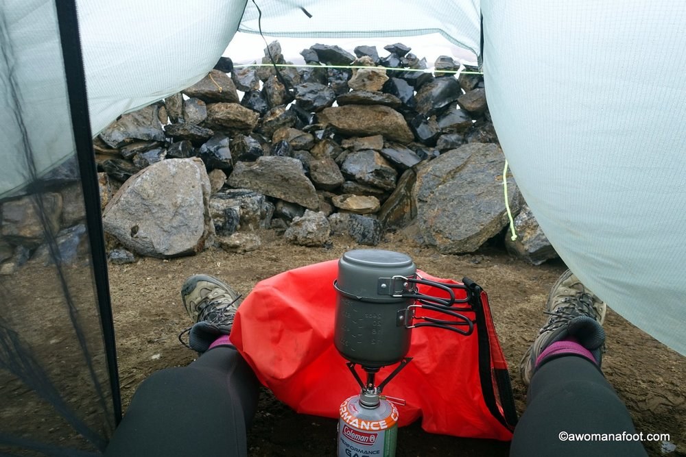 Learn a few good tips and hacks to reduce the risk of condensation while camping! Read on how to avoid condensation @ awomanafoot.com | How to minimize moisture in tent | Reducing condensation | Advice for campers | Camping in rain | #Camping #Backpacking #Adventure #Hiking |