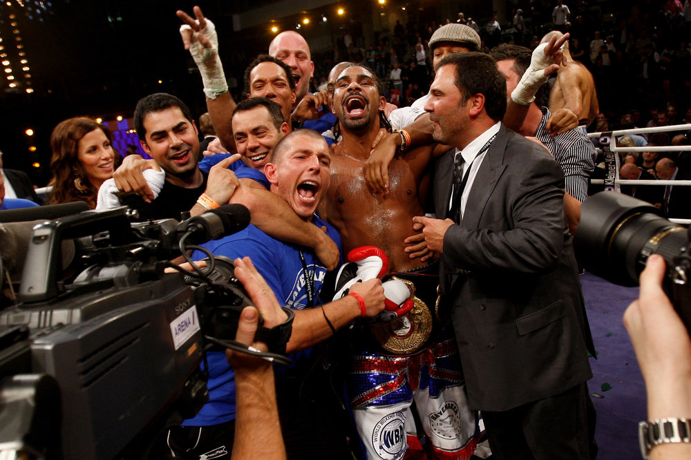 The team celebrate after capturing the WBA Heavyweight title.