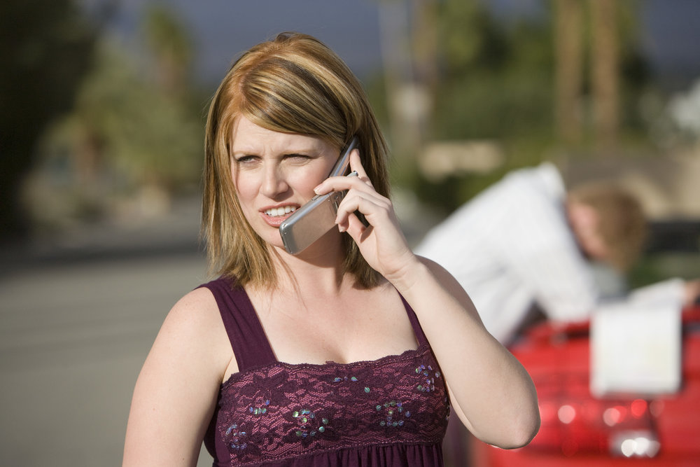 Couple on phone with car trouble