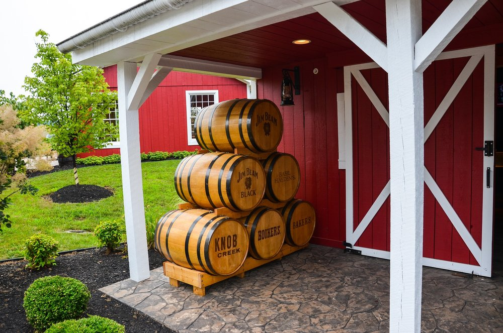 "A display of    Jim Beam's ""Small Batch Collection""   (released between 1988-1992) is arranged in a barrel pyramid just outside the Tasting Room next to ""Warehouse H."""