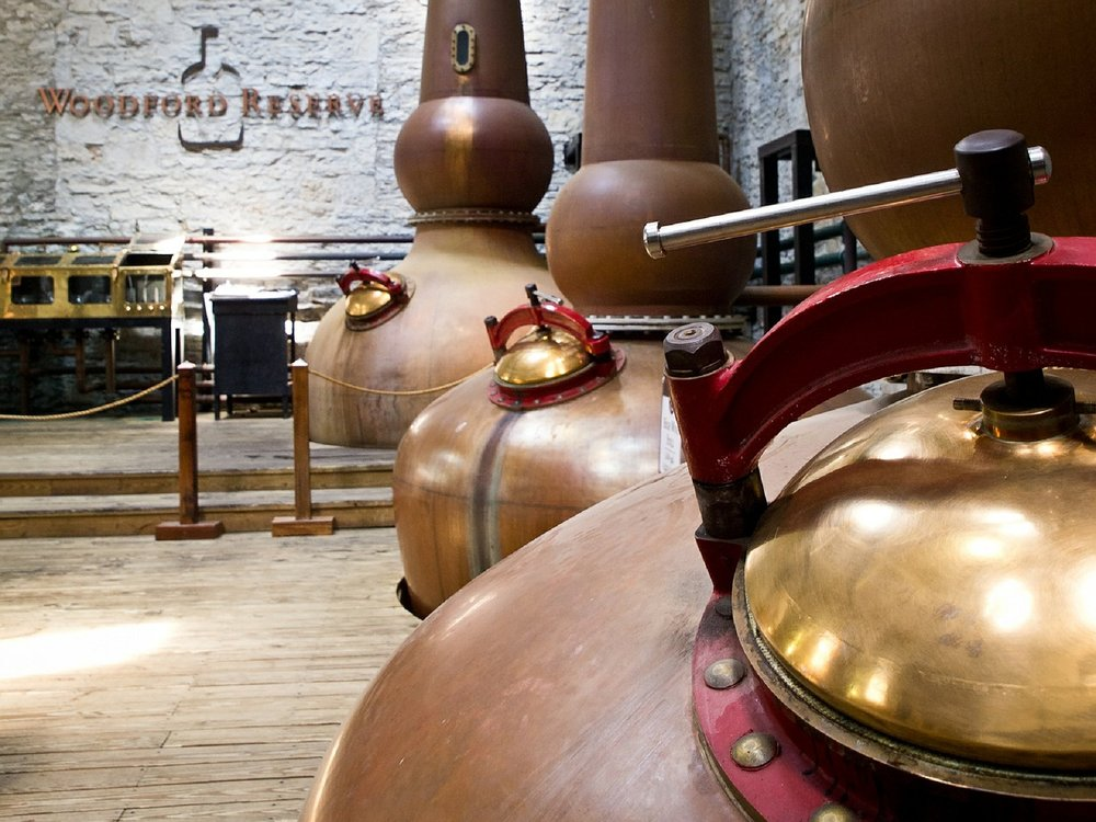 Brown-Forman   owned   Woodford Reserve   has three  iconic Copper Pot Stills  which now identifies itself as their logo.
