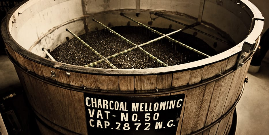 "Ten foot deep vats of   Sugar Maple Charcoal are used as part of  ""Lincoln County Process""  to filter Jack Daniel's. It is this step that differentiates Tennessee Whiskey from Bourbon."