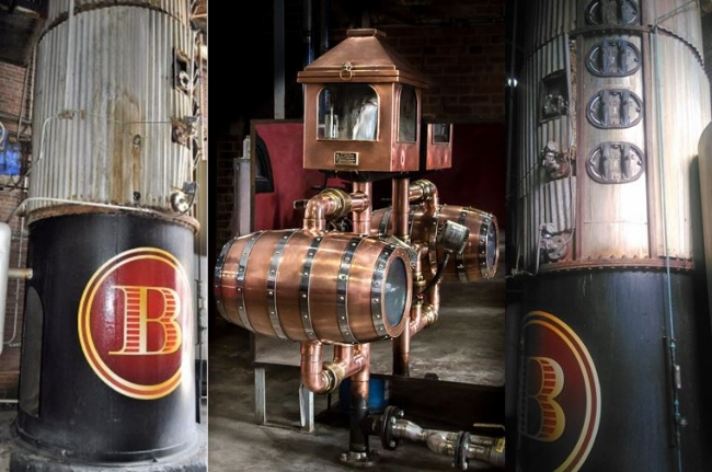 The 60 year-old   Column Still  is five stories tall  and six foot in diameter and appears here with the Barton Logo displayed on it as it eventually leads to a beautiful   Copper Tailbox  .