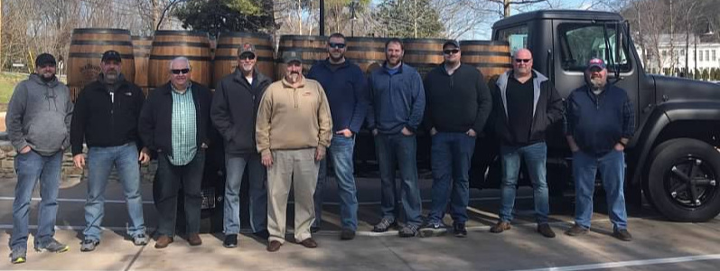 Some of the Administration and Staff of Whiskey University posing during their Tennessee Whiskey Quick Trip in January 2019. The trip included visits to George Dickel Distillery, Jack Daniel's Distillery and Prichard's Distillery. Pictured above (left to right):   Professor Lt. Colonel Carl Ingrum, Troy Rubert, Professor Lt. Colonel Dale Robinson, Scott Wauford, Professor Colonel Craig Duncan, Dakota Mercer, Josh McCrory, Casey Willimas, Scott Jackson   and   Dax Russell.