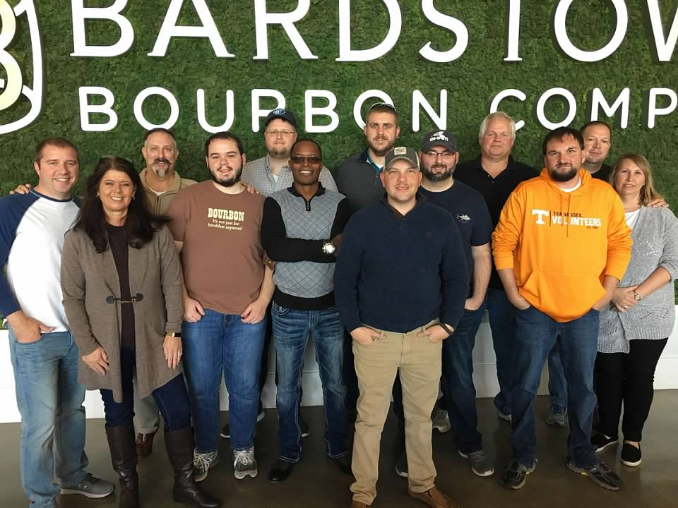 Some of the   Staff and Administration of Whiskey University   at the   Bardstown Bourbon Company   which is the distillery in which all Western Spirits products are made. Pictured above (from left to right);   Professor Lt. Colonel Christopher Hart, Administrator Melissa Duncan,   founder of Whiskey University   Professor Colonel Craig Duncan, Bobby Graham, Casey Williams, Devere Walker, Dakota Mercer,   guest,   Professor Lt. Colonel Christopher Yow Professor Lt. Colonel Ross Osborne, Professor Lt. Colonel Carl Ingrum, John Hunter   and Monya Hunter.