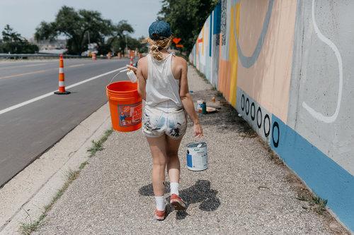 ellen rutt working on a mural.jpeg