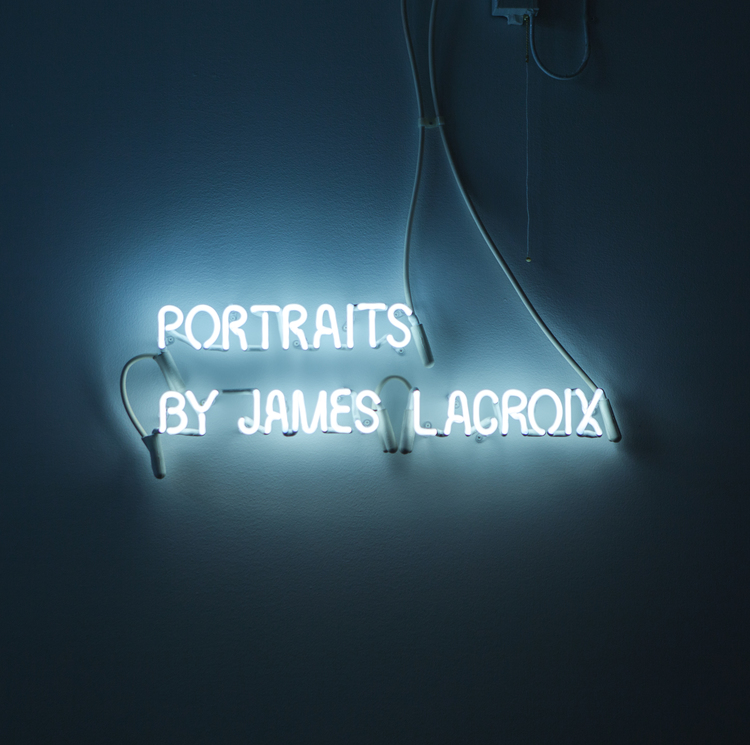 Portraits by James LaCroix installation neon sign by Neon Connection