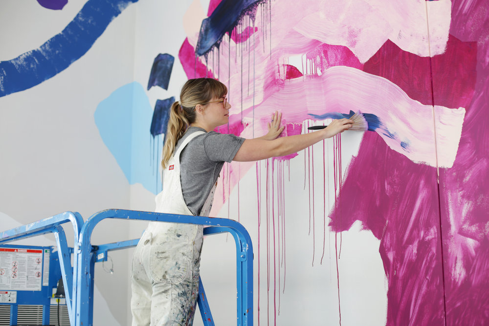 Heather Day working on a large0scale mural for UICA as part of Color of the Year