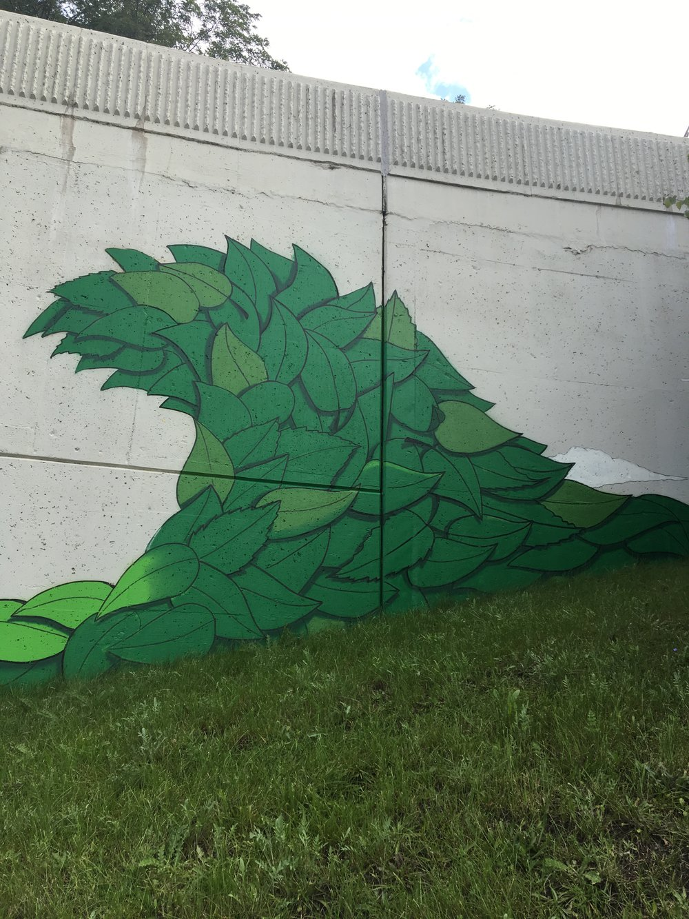 Green leaf detail of retaining wall mural