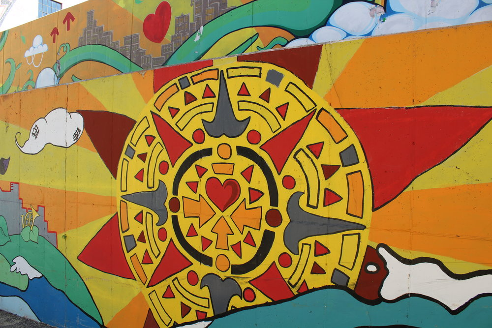 Indigenous inspired sun detail on Artworks mural on S. Division St.