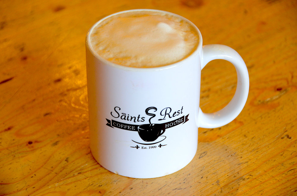 latte with perfect foam in saints rest mug.JPG