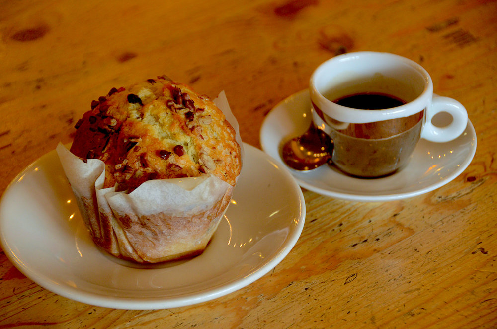 espresso and a muffin sprinkled with pecans.JPG