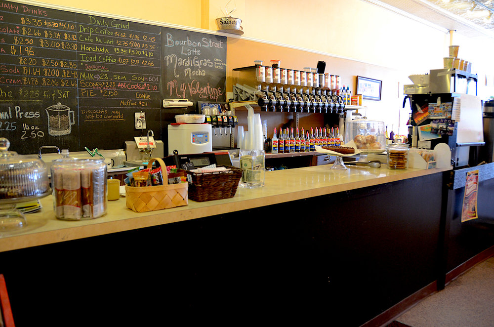 welcoming counter with bulk coffee beans and bakery menu.JPG