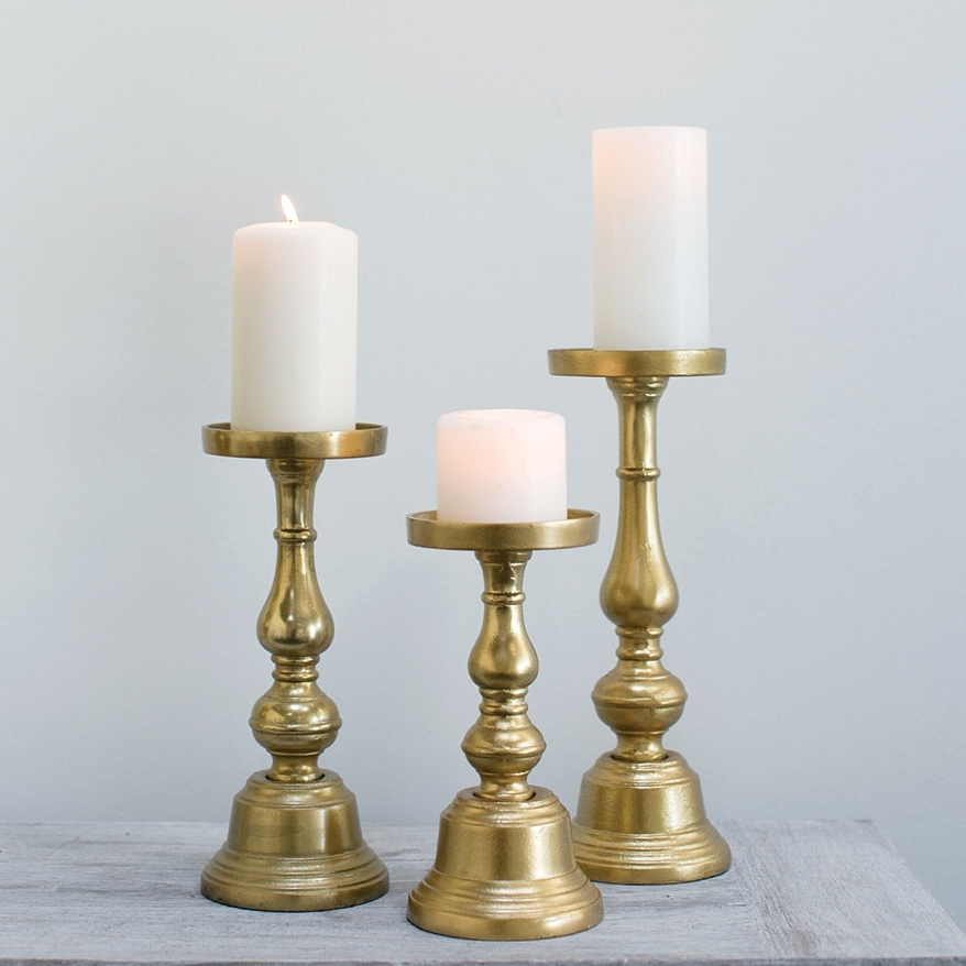 Brassy Gold Pillar Candle Holders An Affair To Remember