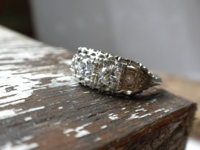 Delicate vintage three stone diamond ring