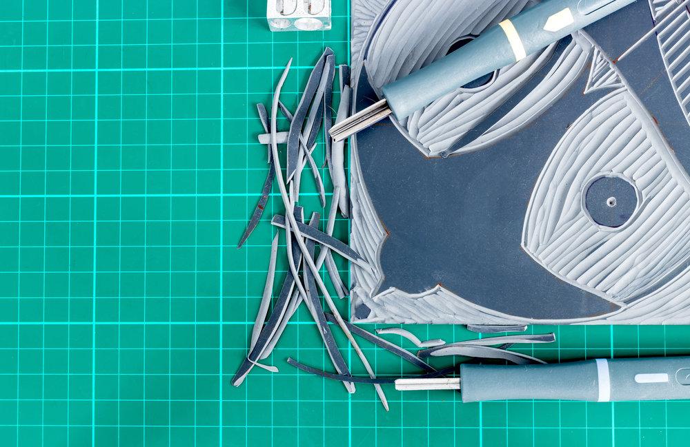 bigstock-Lino-Cutting-Tools-On-A-Deskto-229021213.jpg