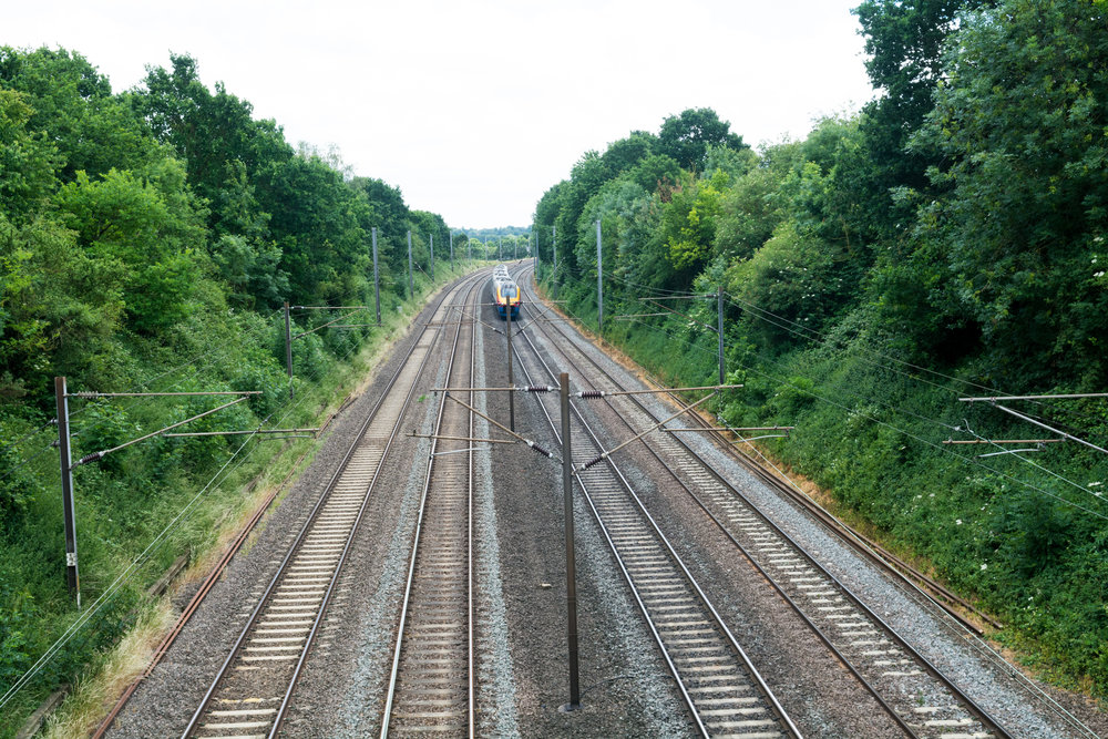 bigstock-Fast-Train-Travelling-On-The-T-247077874.jpg