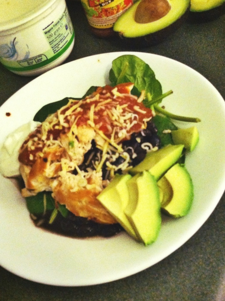 Deconstructed Burrito of Chicken Breast, Black Beans, Avocado, Salsa and Cheese on Spinach.