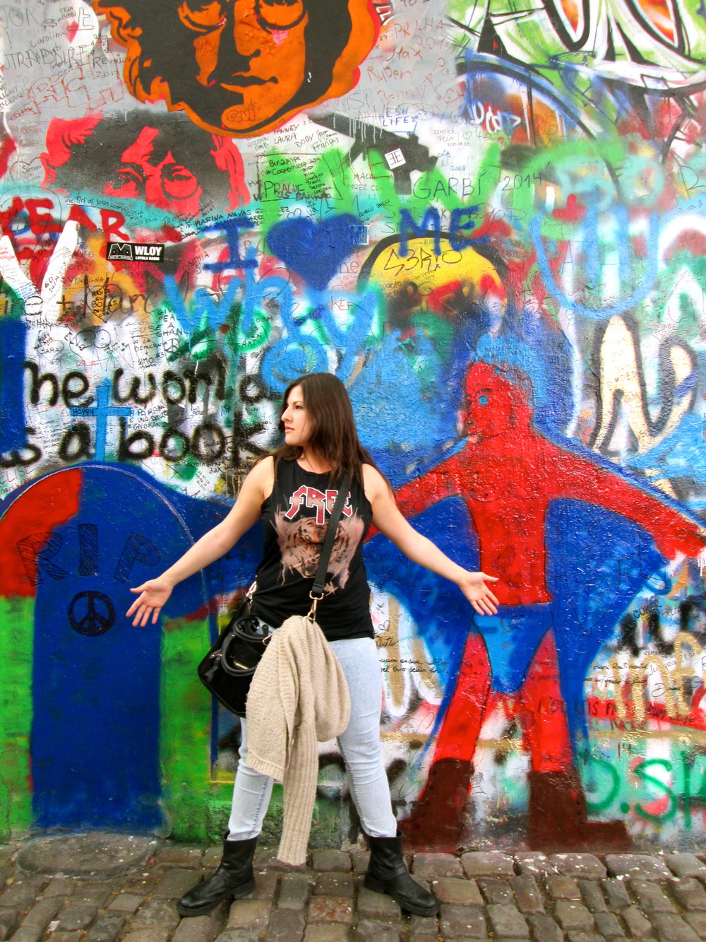 Posted up at the Lennon Wall.