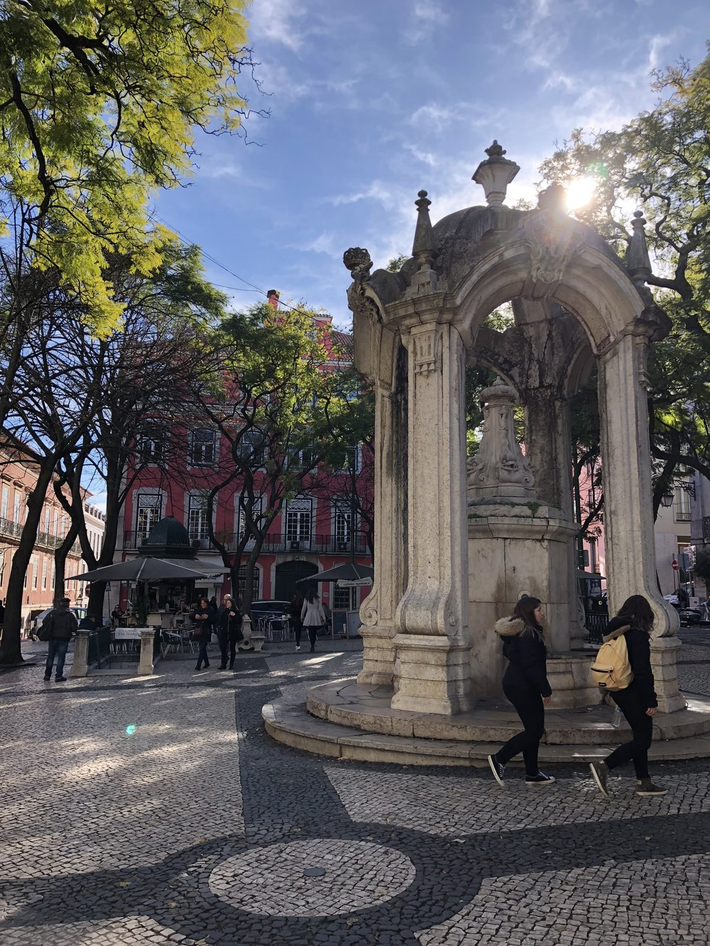Chafariz do Carmo, an 18th-century fountain in the middle of a little town square.