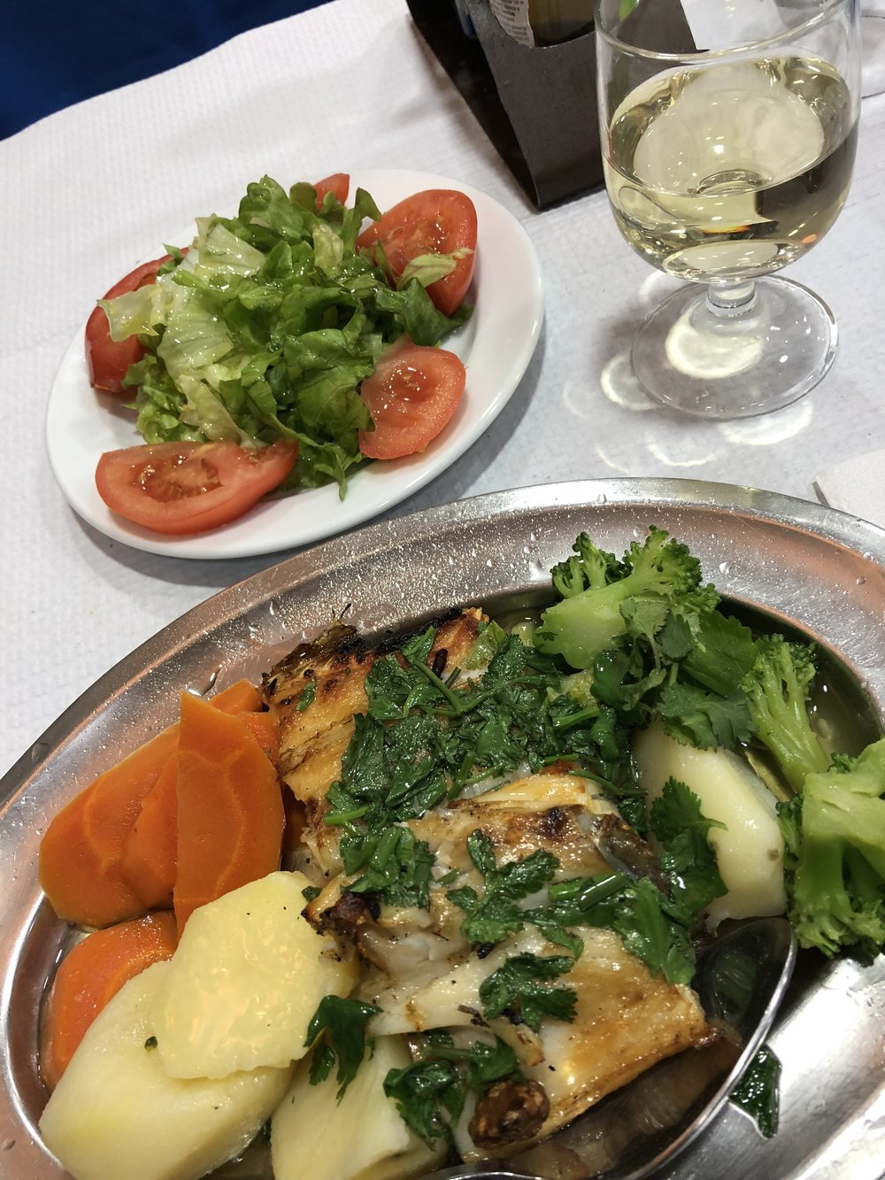 Lunch at Paco Real of house cod, veggies, salad & white wine.