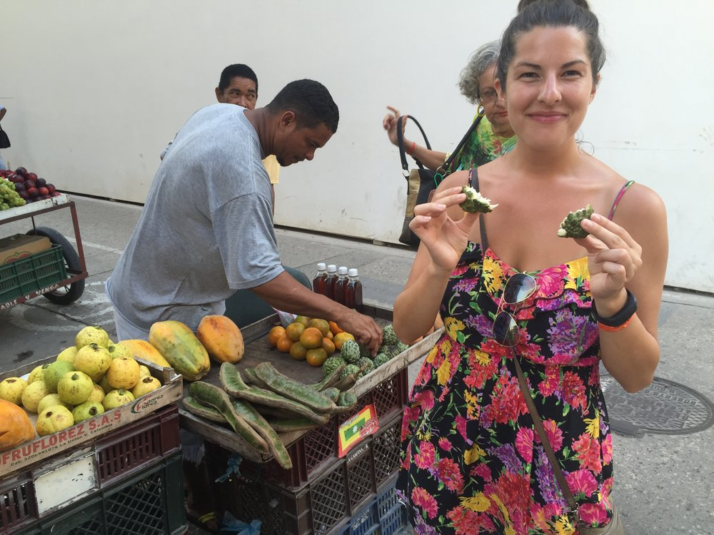 Enjoying a fresh fruit on the streets of Cartagena. I never did catch the name, but it was so yummy!