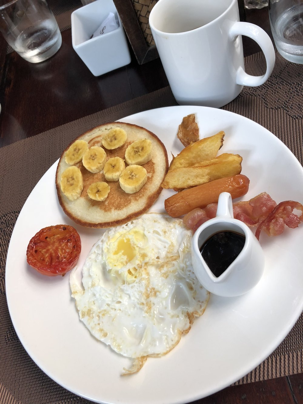 Breakfast (fo free) at the hotel in Phnom Pehn! Note that sausages = hot dogs in Cambodia.