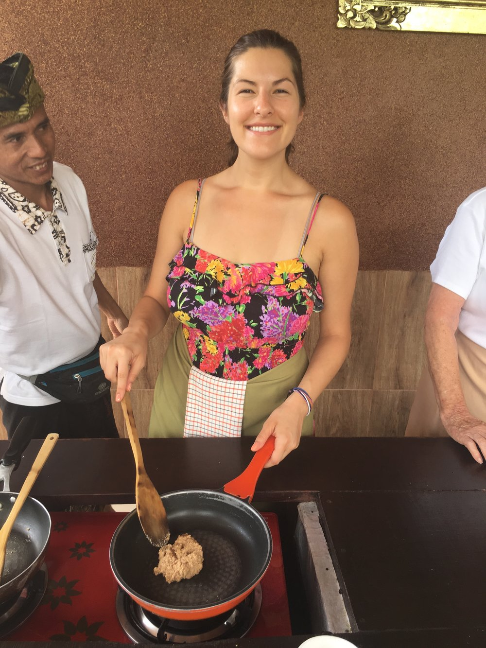 Sweltering as I cook up some chicken satay at our cooking class.