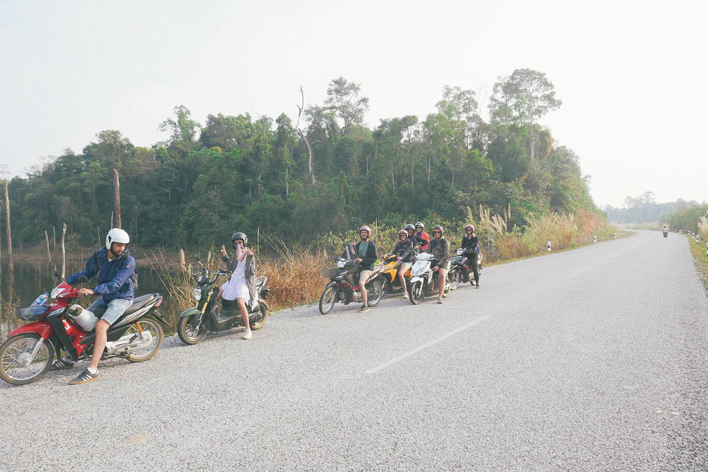 Our 9-person motorbike gang from all over the world, doing the Thakek loop together in Laos.