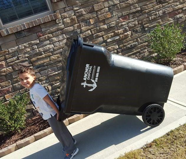 kid with trash can