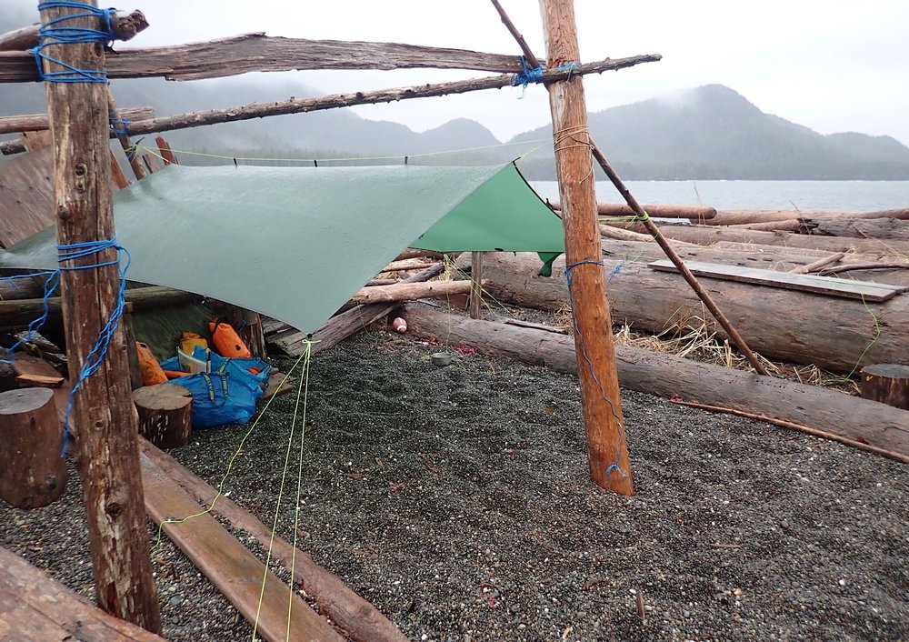 Someone built a fort on the beach... the perfect place to hang the tarp!