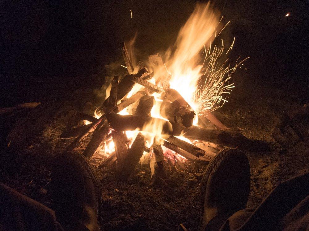 Enjoying a fire on the beach.