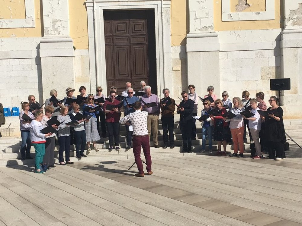 Singing Danny boy outside the church in the main square in Porec.