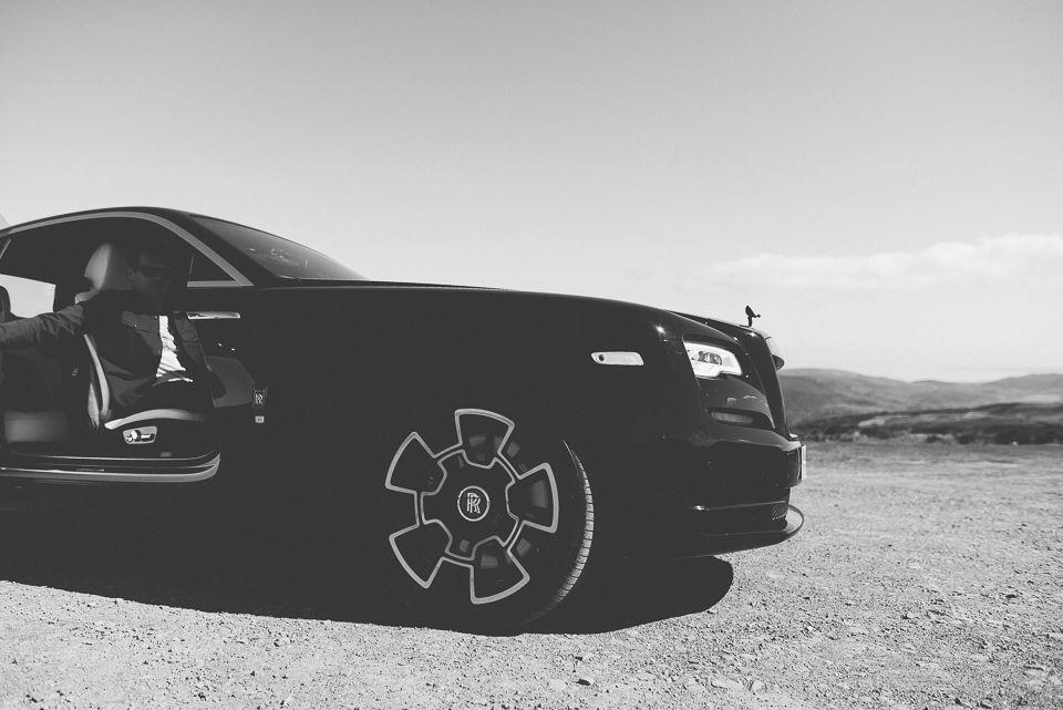 Suicide doors opening on Rolls Royce Wraith Black Badge.