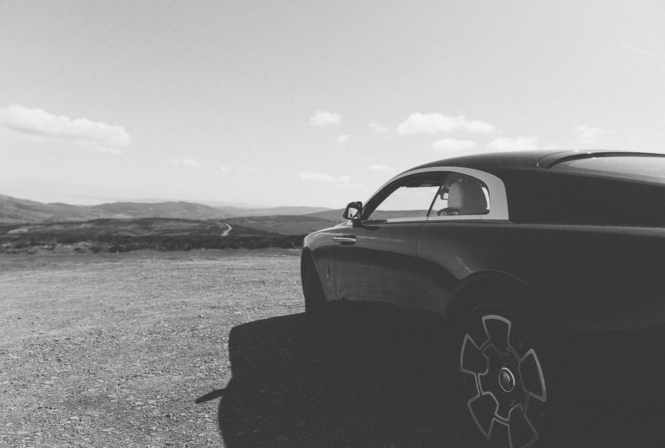Rolls Royce Wraith Black Badge looks out on Cornish countryside
