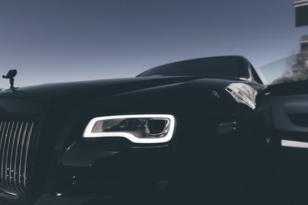 Front on shot of Rolls Royce Wraith Headlight, showcases its edge of design.