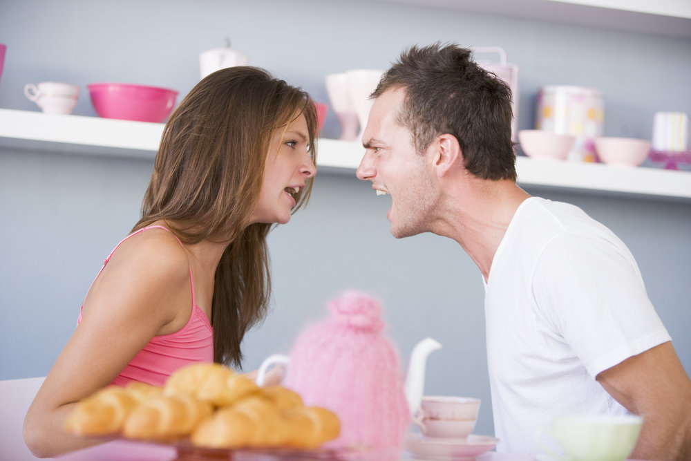 example of an angry couple fighting