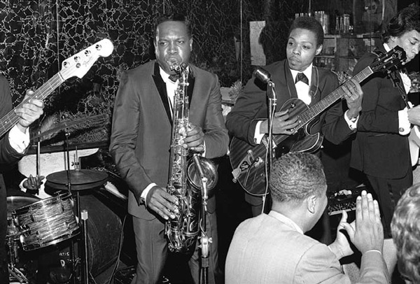 "This ATCO promo shot shows Dupree with saxophonist King Curtis and James Marshall Hendrix (playing a right-handed Fender Jazzmaster upside down at far right) at a May 5, 1966, record-release party for Percy Sledge. Photo by William ""PoPsie"" Randolph"