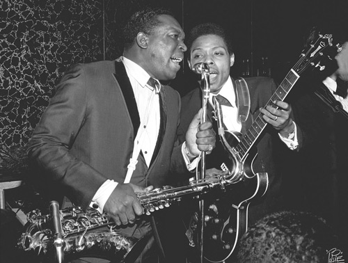 "Dupree picks an early-'60s Guild Starfire III with two DeArmond single-coils and a Bigsby B6 tremolo as he shares the mic with King Curtis at a 1966 record-release party for Percy Sledge. Photo by William ""PoPsie"" Randolph"
