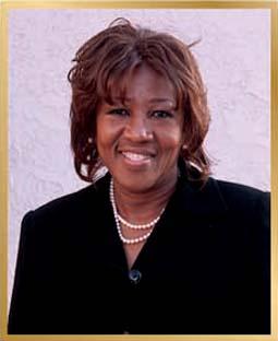 Carol Barton-Forbes    Associates Director